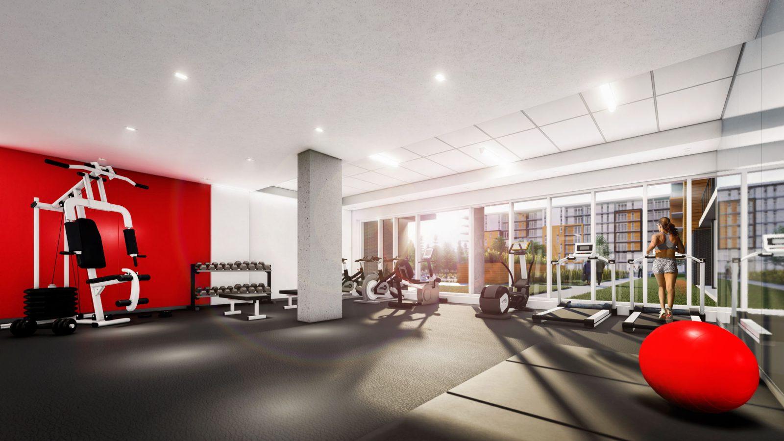 Salle de gym bien équipée avec des fenêtres qui vous donneront l'impression de courir et rouler dehors!
