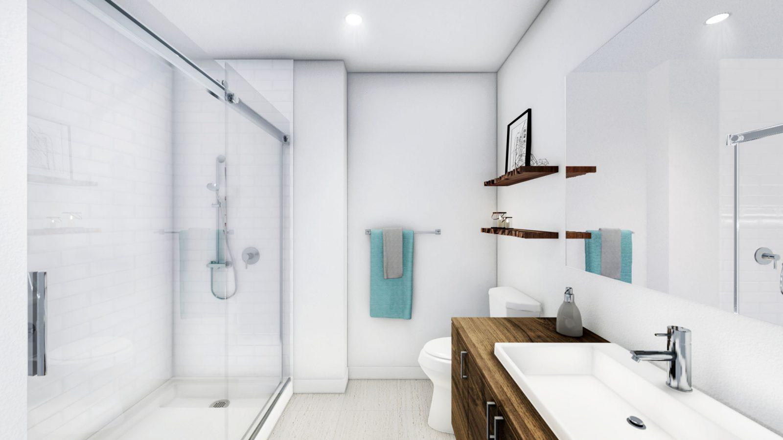 Salle de bains dotée d'une immense douche vitrée.